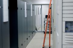 Ladder in Equipment Hall. Telecommunication equipment hall, ladder, racks royalty free stock image