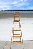 Ladder in front of house Stock Image