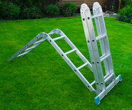 Ladder on a grass. Stairs on the green grass Stock Image