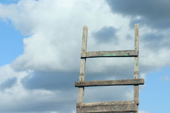 Ladder in heavens. Ladder removed against the cloudy sky in the afternoon Royalty Free Stock Photo