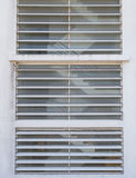 Ladder in house in window on facade Royalty Free Stock Photos