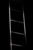 Ladder leading from light to dark Stock Image