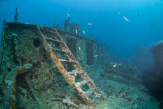 Ladder leading to the bow deck of a shipwreck. stock photography