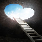 Ladder leading to heart shaped opening Stock Photos
