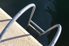 Ladder leading into the water Stock Images