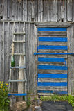 Ladder leaning against a wooden wall. Weathered wall of old barn with a old ladder Stock Photo