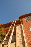 Ladder leaning on tall building.  Royalty Free Stock Photo