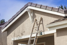 Ladder Leaning Up Against A House Ready For New Paint Royalty Free Stock Photos