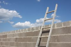 Ladder Leaning on Wall Stock Photo