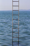 Ladder in the middle of the sea Stock Image