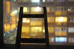 A ladder near the window, Siluets ladder. Stock Photo