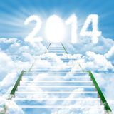 A ladder the new future 2014. Illustration of a ladder leading upward to the new year 2014 Royalty Free Stock Photography