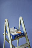 Ladder, paint can and paint roller Stock Image