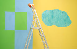 Ladder by painted walls Royalty Free Stock Image