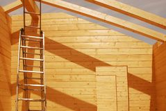 Ladder in Partially Constructed Wooden House Stock Images