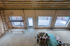 Ladder, parts of scaffolding and construction material on the floor during on the remodeling Stock Photos
