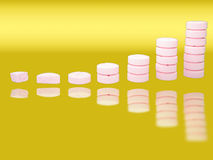 Stacks of pharmaceutical drugs with reflections Royalty Free Stock Images