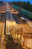 Ladder and platform of the railway station. At night Stock Image