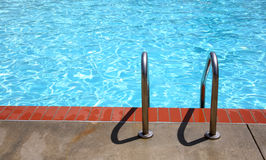 Ladder and pool edge. Pool edge with ladder royalty free stock photos