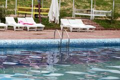 Ladder in the pool in the nature Royalty Free Stock Photos