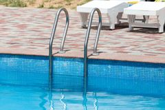 Ladder in the pool in the nature Stock Photo