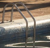 Ladder in the pool in the nature Royalty Free Stock Photography