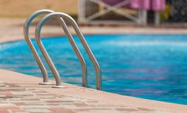 Ladder in the pool in the nature Royalty Free Stock Photo