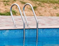 Ladder in the pool in the nature Royalty Free Stock Images