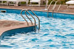 Ladder in the pool in the nature Stock Image