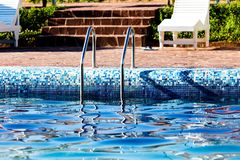 Ladder in the pool in the nature Royalty Free Stock Image