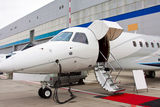Ladder in a private jet. Lowered ladder of a small private plane on the ground Royalty Free Stock Photography