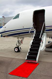 Ladder in a private jet. Lowered ladder of a small private plane on the ground Royalty Free Stock Photos
