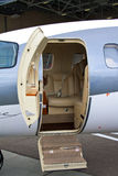 Ladder in a private jet. Lowered ladder of a small private plane on the ground Royalty Free Stock Image