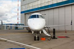 Ladder in a private jet. White reactive private jet, the front landing gear and a ladder Royalty Free Stock Photography