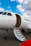 Ladder in a private jet. And red carpet on blue sky Royalty Free Stock Photography