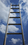 Ladder reaching into a blue sky Stock Images