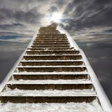Road to a different world. Ladder road with snows leading to a new world through sky and clouds. Surreality abstract background stock photos