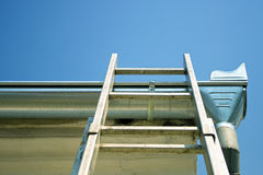 Ladder on the roof. New shiny ladders on the roof Royalty Free Stock Photos
