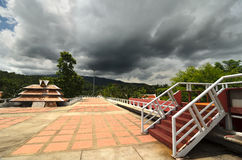 Ladder and a rooftop under stunning stormy sky. Hot day in a park Stock Image