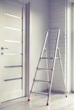Ladder in the room. Aluminium ladder in the bright modern interior stock photo