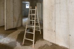 Ladder in rooms on a construction site Stock Photo