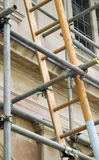 Ladder and scaffolding. Outside an old building royalty free stock images
