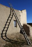 Ladder and Shadow at San Lorenzo Church, Picuris Pueblo, NM Stock Photos