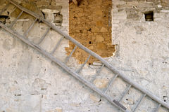 Ladder on side of old building Royalty Free Stock Photo