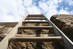 Ladder on side of wall Stock Photo