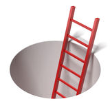 Ladder standing inside hole Stock Photos