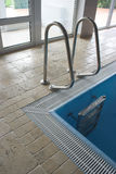 Ladder in swimming pool Stock Photo