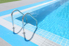 Ladder in the swimming pool. The ladder in the swimming pool Stock Images