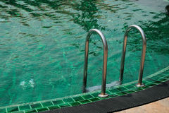 Ladder in the swimming pool. Stock Photo