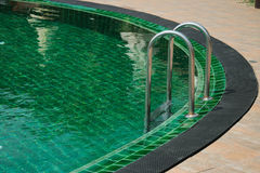 Ladder in the swimming pool. Stock Photos